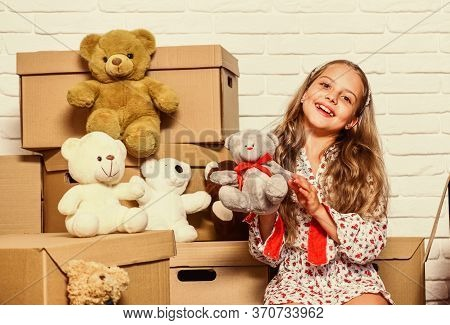 Girl Small Child And Boxes. Delivering Your Purchase. Moving Routine. Packaging Things. Prepare For