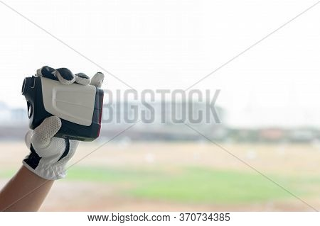 Female Hands Wearing Professional Glove With White And Black Modern Optical Range Finder Used For Go
