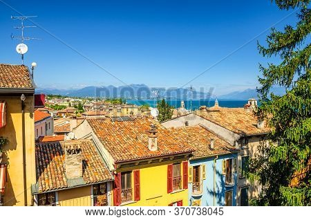 Aerial Panoramic View Of Desenzano Del Garda Town With Red Tiled Roof Of Colorful Buildings With Shu