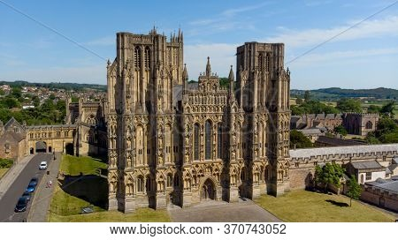 Wells, Somerset Uk - June 2020: Aerial View Of Wells Cathedral And The Surrounding Fields In Somerse
