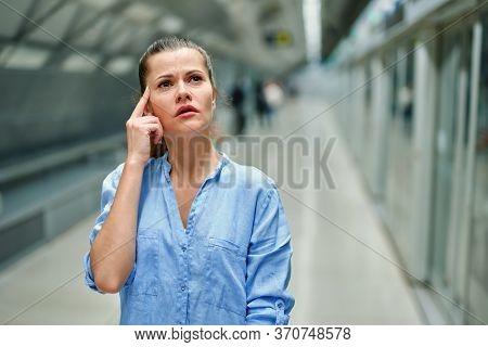 Sad Young Woman With Handbag In Subway Station