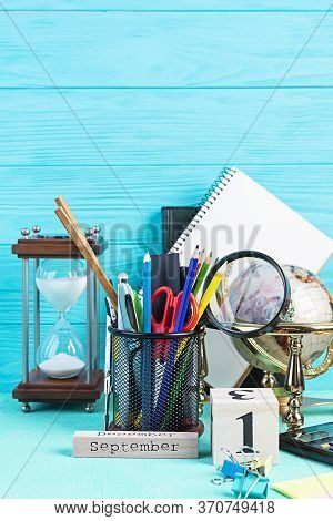 Different School Supplies On Blue Background. Concept Back To School