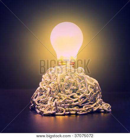 Glowing bulb in ball of chains