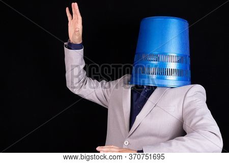 A Paperback Businessman On The Head. Concept Trash In The Head, Wrong Decisions. Mistakes In Managem