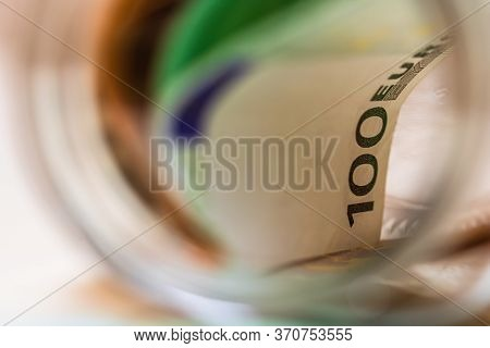 Concept Of Investing And Keeping Money, Close Up Isolated. Composition With Saving Money Banknotes I