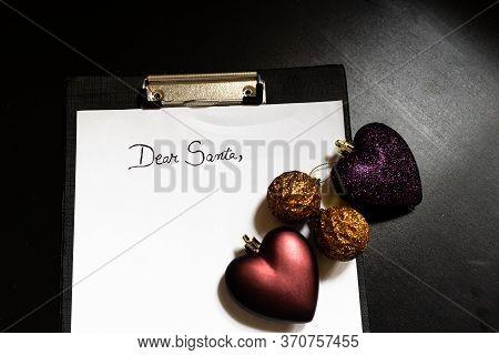 Writing Dear Santa For Christmas. Christmas Letter. Text Dear Santa On Paper.