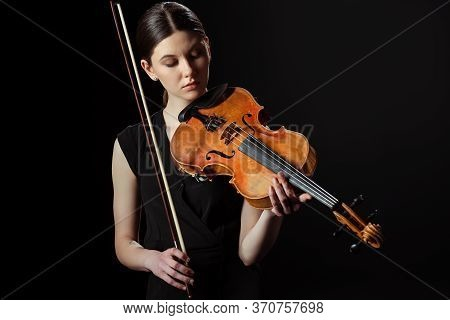Musician Playing Symphony On Violin Isolated On Black