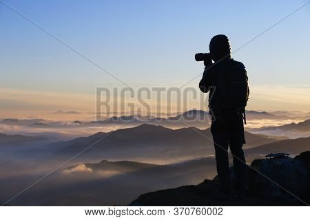 Munitibar, Bizkaia/basque Country; Jan. 04, 2019. Photographer Taking The Sunrise From The Top Of Mo