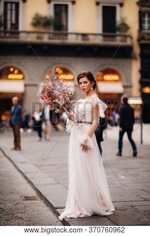 The Girl-bride Is With Beautiful Flower Pattern As A Mask In Florence, Stylish Bride In A Wedding Dr