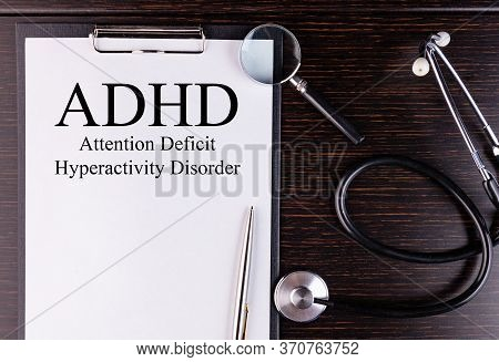 Paper With Text Adhd - Attention Deficit Hyperactivity Disorder, On A Table With A Stethoscope And M
