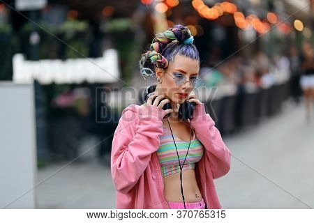 Fashion Cool Funky Girl In Headphones Listening To Music Wearing Colorful Pink Sweater And Fancy Sun