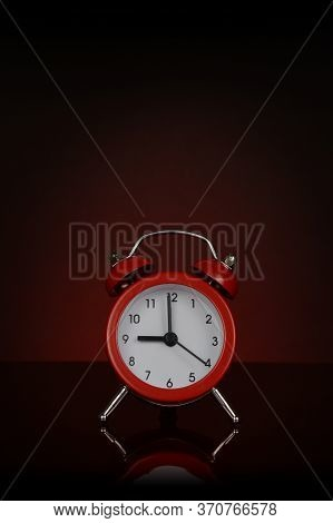 A Closeup View Of A Vibrant Red Desk Alarm Clock.