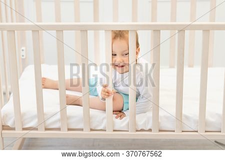 Baby In The Crib Waiting For Mom, Baby 2 Years In The Crib