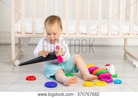 Child Playing Near The Crib, Baby Boy 2 Years Old Sitting With Toys, Early Development