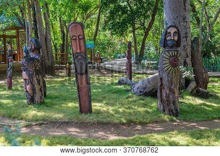 Santo Domingo, Dominican Republic-march 13, 2020: Sculptures In Tree Trunks At Los Tres Ojos (the Th