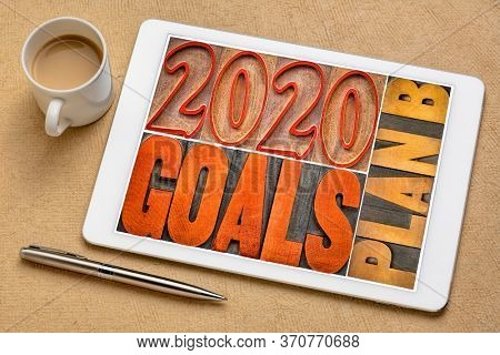2020 goals plan B banner in vintage letterpress wood type on a digital tablet with a cup of coffee - revision and changing business or personal plans and goals concept
