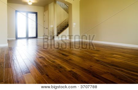 New home with beautiful hardwood flooring in living room area poster