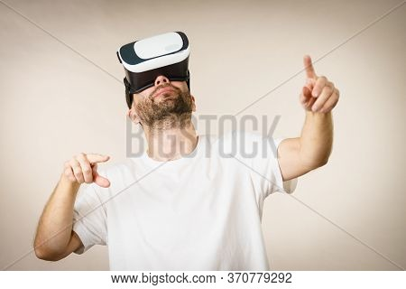 Adult Short Bearded Guy Exploring Virtual Reality Wearing Vr Goggles Being Into Technology.