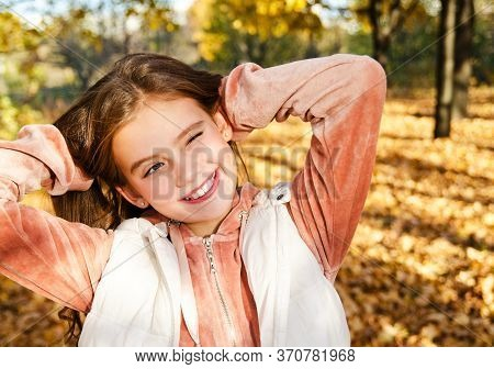 Autumn Portrait Of Adorable Smiling Little Girl Child Preteen In The Park Outdoors