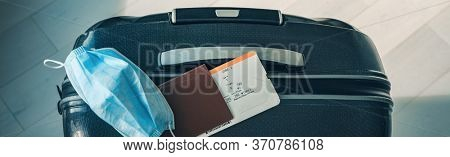COVID-19 travel restriction due to corona virus mask wearing obligatory in airport and airplane flights to Europe, Asia. Passport, ticket and suitcase ready for holidays. Panoramic banner.