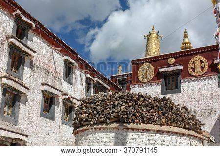 Drepung Monastery Buildings And Log Storage Near Lhasa, Tibet, Asia