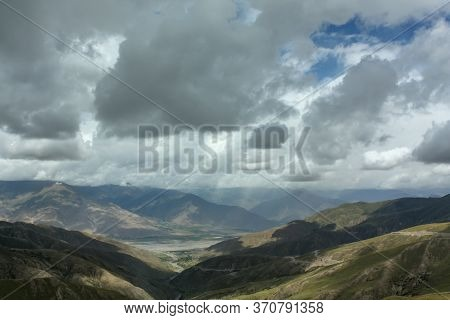 Highpass In Tibet Not Far Away From Lhasa With Clouds Hanging Very Low