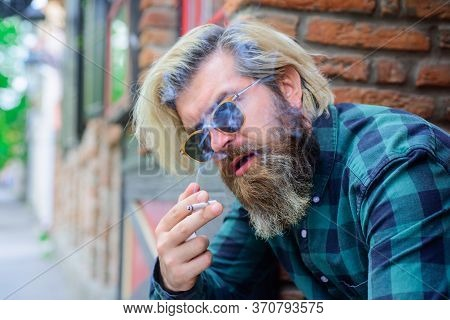 Cigarette Smoke. Close Up Portrait Of Smoking Man. Sensual Bearded Hipster With Cigarette. Man Smoke
