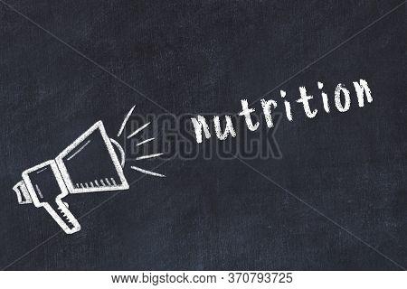 Chalk Drawing Of Loudspeaker And Handwritten Inscription Nutrition On Black Desk