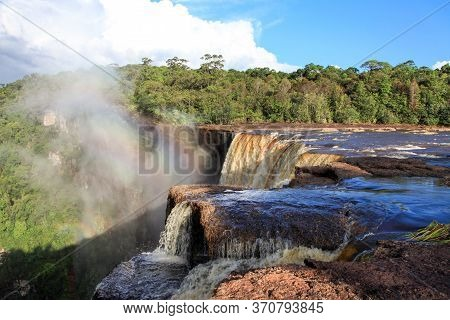 View Of The Beautiful Powerful Kaieteur Waterfall On A Clear Sunny Day Against The Background Of The
