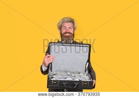 Successful Businessman Holds Briefcase With Money. Dollar Currency Cash. Wealth And Rich. Bearded Ma