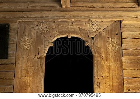 Rustic Wooden Passage Religion Building Arch Shape With Pagan Signs On Surface And Black Space In Ce