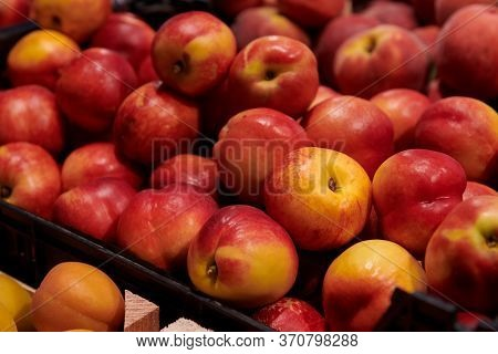 A Bunch Of Ripe Nectarines. Delicious Fresh Fruits At The Market. Fruits Harvesting.
