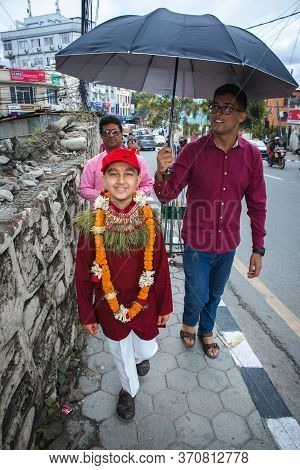 Kathmandu,nepal - June July 6,2019: Hindu Boy Returning Home From Temple With His Maternal Uncle Dur