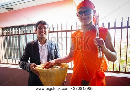 Kathmandu,nepal - June 11,2019: Hindu Holy Boy With His Maternal Uncle During Religious Ceremony Bra