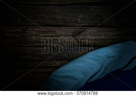 Wonderful Dark Image Of Luhansk Peoples Republic Flag With Large Folds On Old Wood With Empty Place