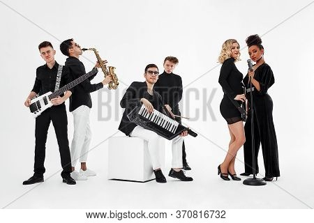 International Group Of Musicians On A White Background, Guitarist, Drummer, Soloists, Saxophonist. C