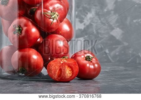 Fresh Large Tomatoes On A Gray Background. Whole And Sliced Tomatoes Shot Closeup With Meta For Text