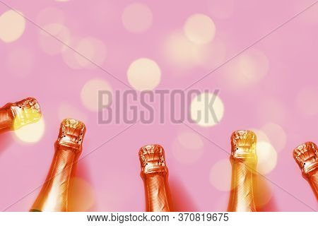 Orange Red Champagne Bottles On A Pink Background With Bokeh Lights Christmas, New Year, Bachelorett