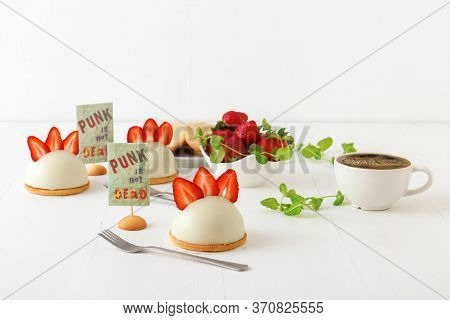 White Table With Mini Cheesecake Hemispheres Embellished With Slices Of Fresh Strawberries Aka Punk