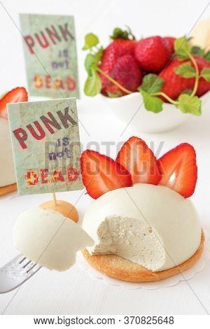 White Table With Mini Cheesecake Hemispheres Embellished With Slices Of Fresh Strawberries Aka Punk