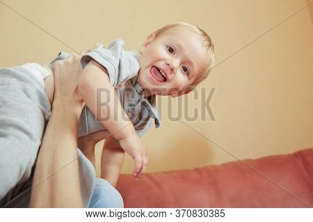 Funny Little Kid Toddler Baby Boy Flying In Father Arm Closeup Portrait. Overjoyed Family Playing Wi