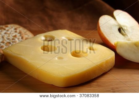 A slice of Danish Jarlsberg cheese, a so-called