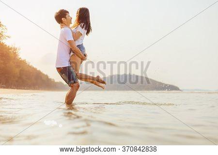 Romantic Couple Having Love And Hug On The Beach.