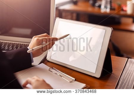 Businesswomen Hand Use Pen For Point On Tablet. People Working On Tablet In The Office.