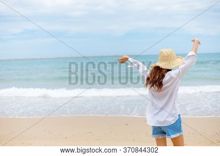 Young Woman In Sun Hat On The  Beach. Summer, Holidays, Vacation, Travel Concept
