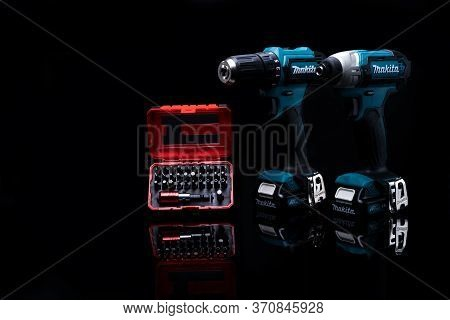 Chonburi, Thailand-may 24, 2020 : Makita Codless Driver Drill With Screw Bit Set In Case On Dark Bac