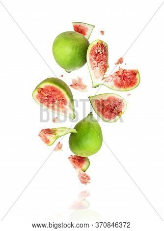 Whole And Sliced Ripe Green Figs In The Air
