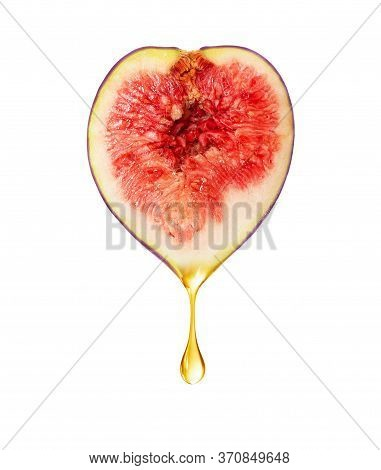 A Drop Dripping From Half A Fig On A White Background