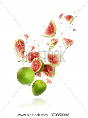 Whole And Sliced Ripe Green Figs Frozen In The Air On A White Background