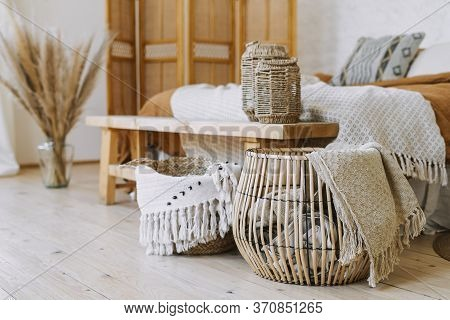 Selective Focus On Home Decor. Comfortable Bedroom In Bohemian Interior Style With Textile Sheet On